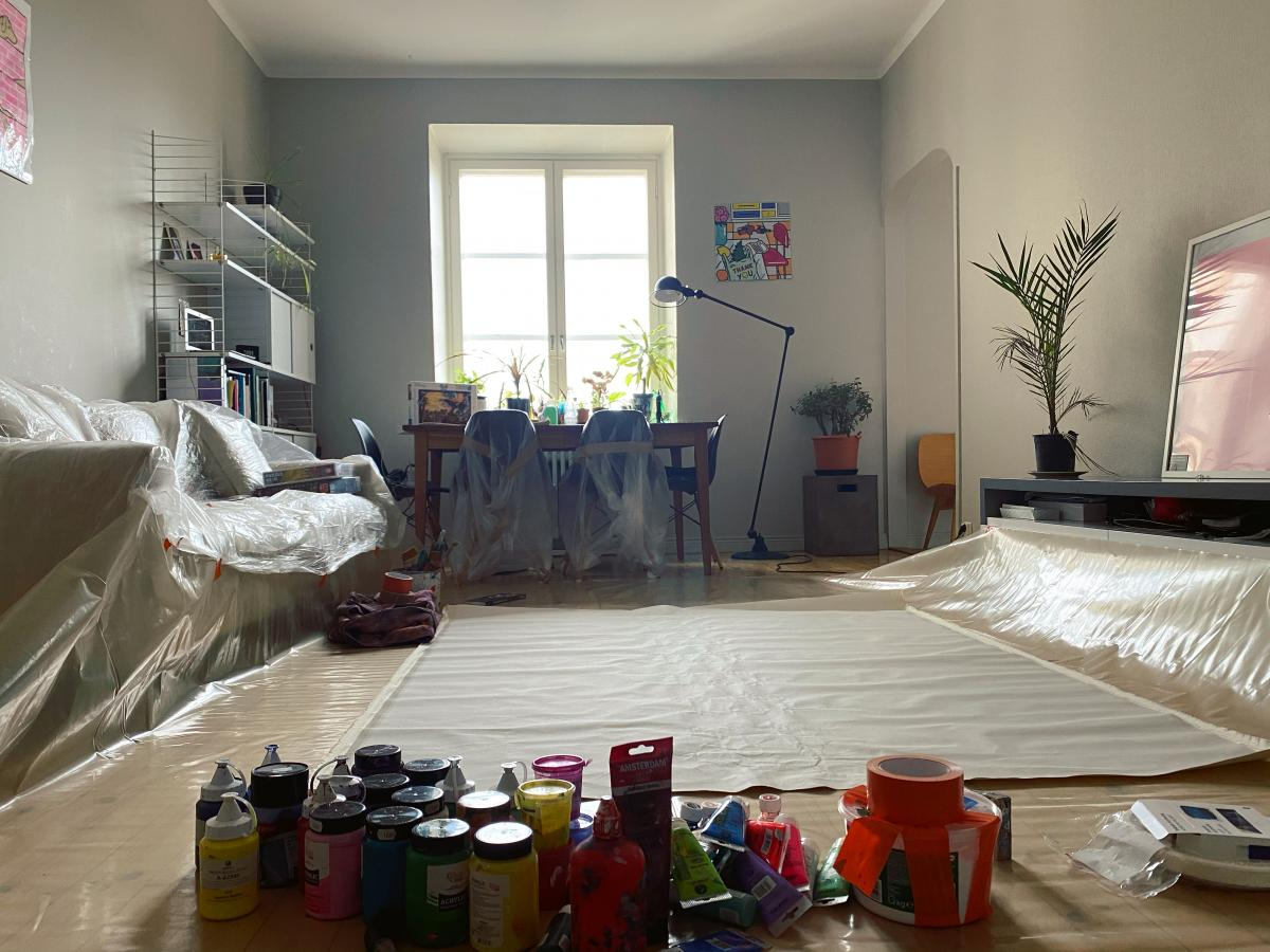 Apartment view with painting material and plastic protection on the floor