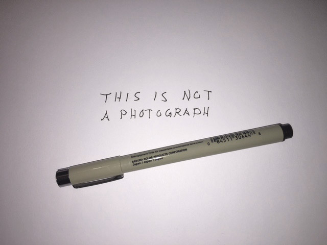 "image showing a pen and a text ""this is not a photograph"""